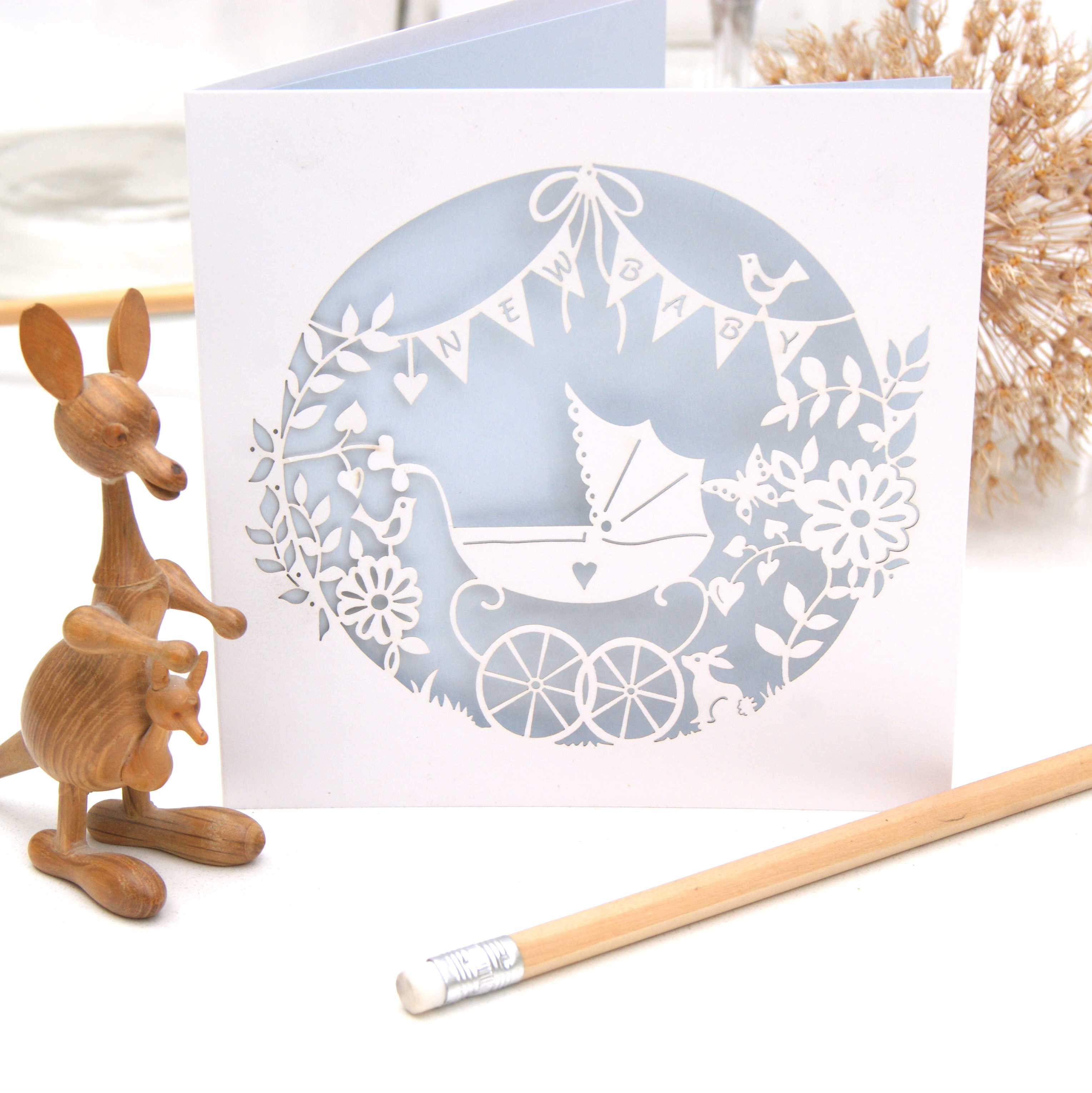 Laser cut new baby card in blue