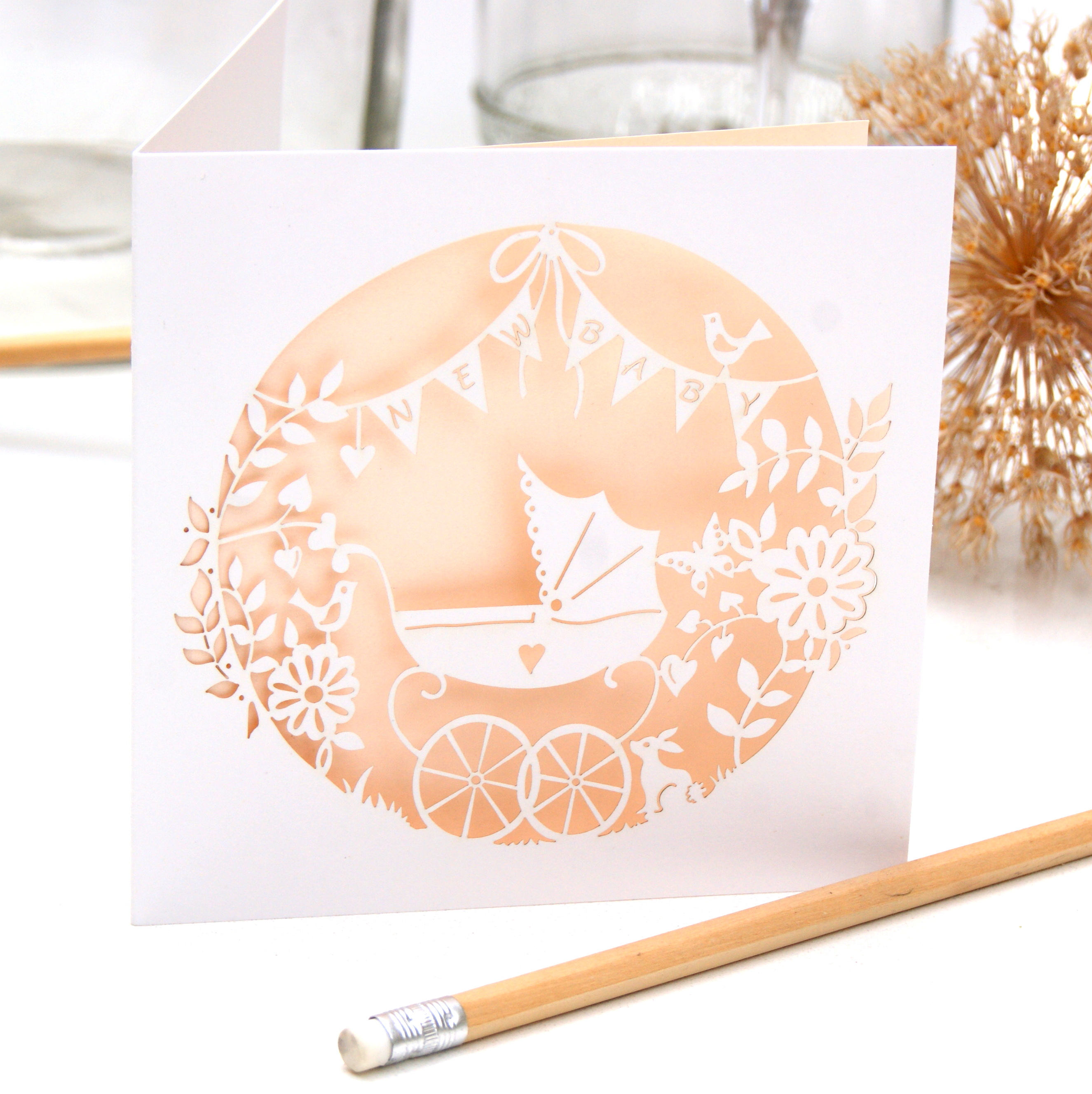 Laser cut new baby card in pale pink