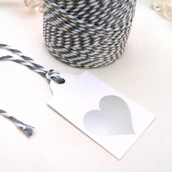 Silver foil heart white gift tag with silver lurex twine