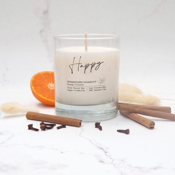 Happy orange and cinnamon candle